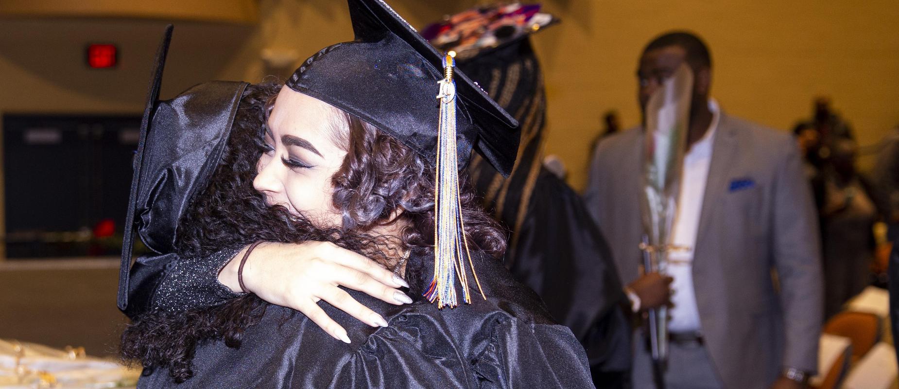 Grads Hugging