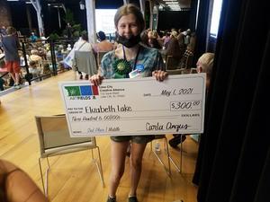 Elizabeth Lake with winning check.jpeg