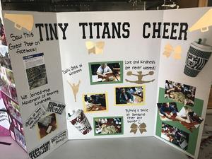 Tiny Titan's community service display board.