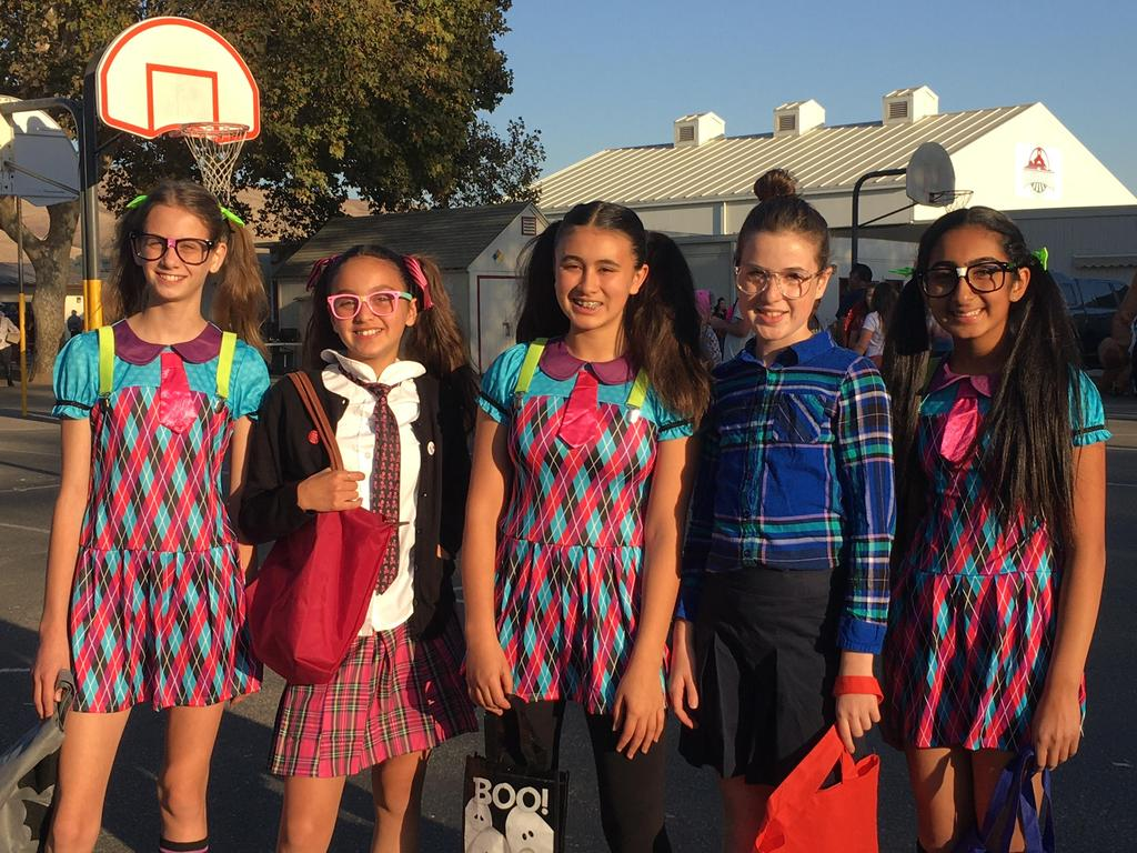 girls dressed up in colorful halloween costumes