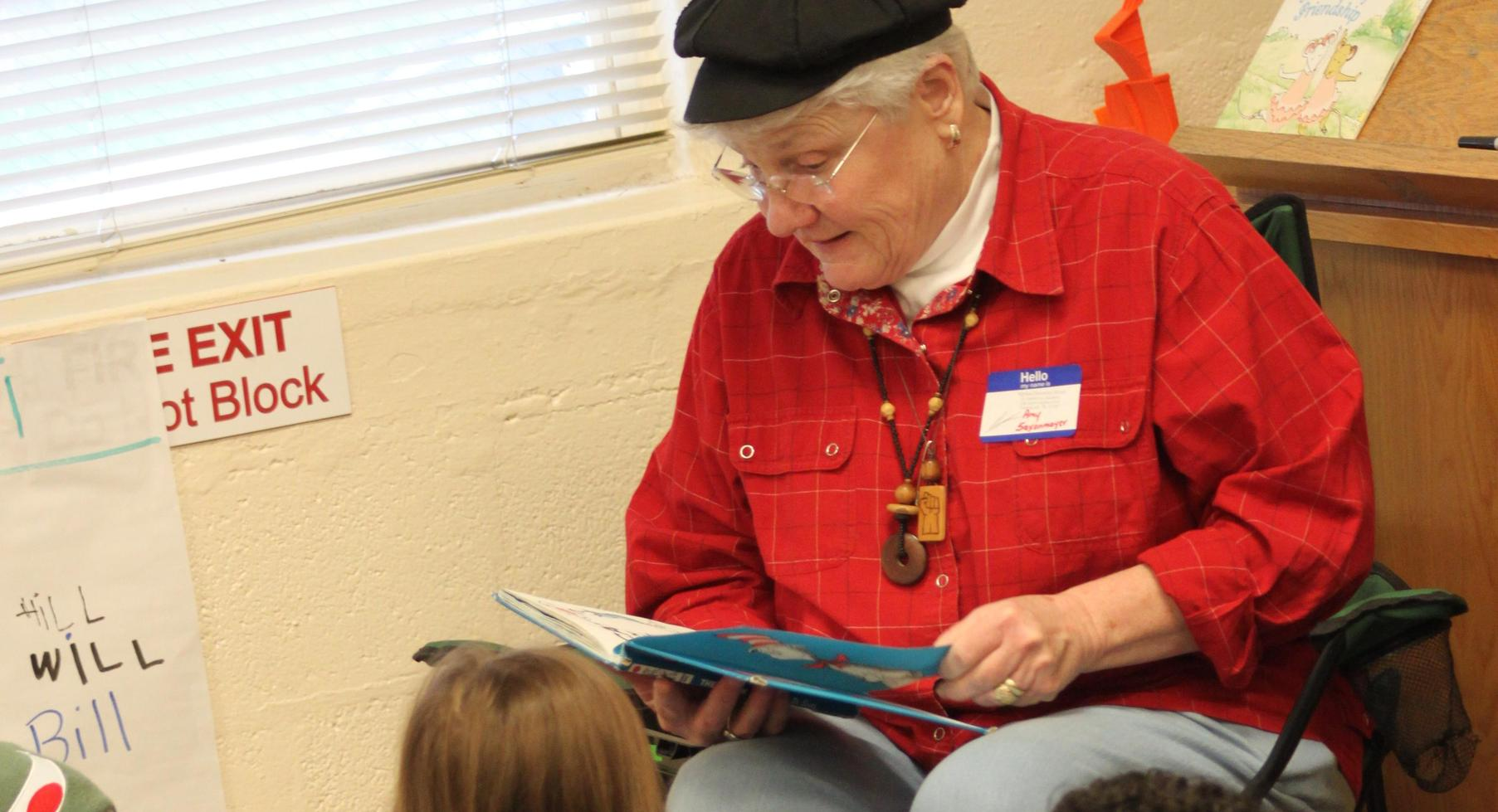 Artist, Amy Saxonmeyer reading to students.