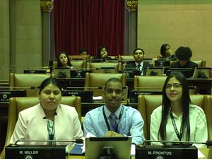 Students sitting in assembly seats.