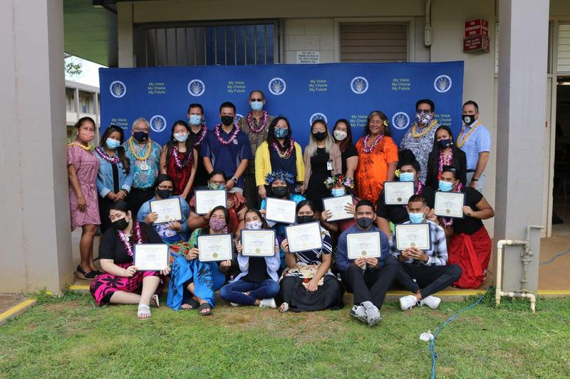 Early College Explorers Program group photo with students, teachers, early college staff, and principal on thei graduation ceremony,