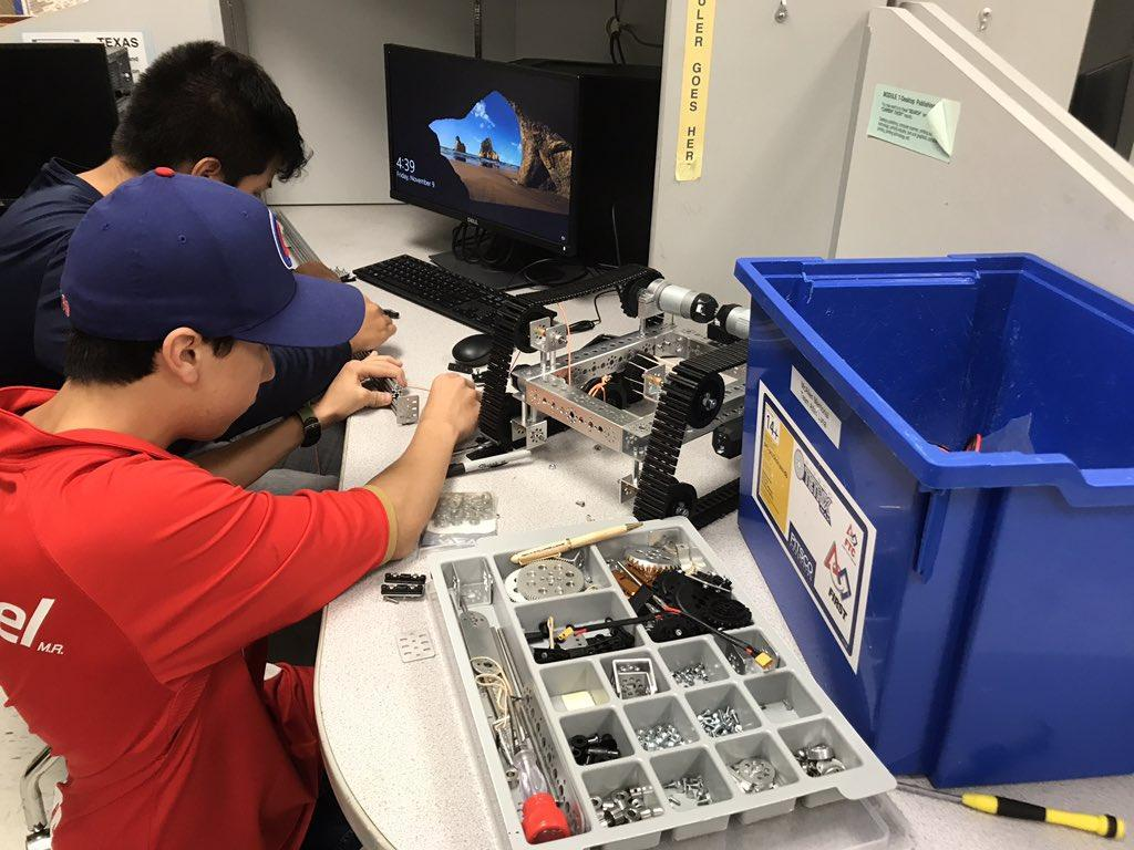 student sitting and working on robotics project