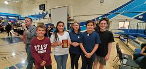 Students posing with award