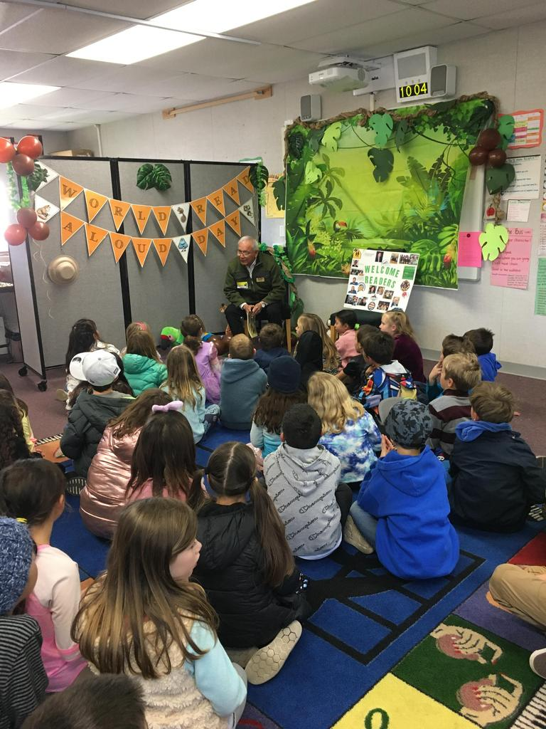 reader prepares to read to students