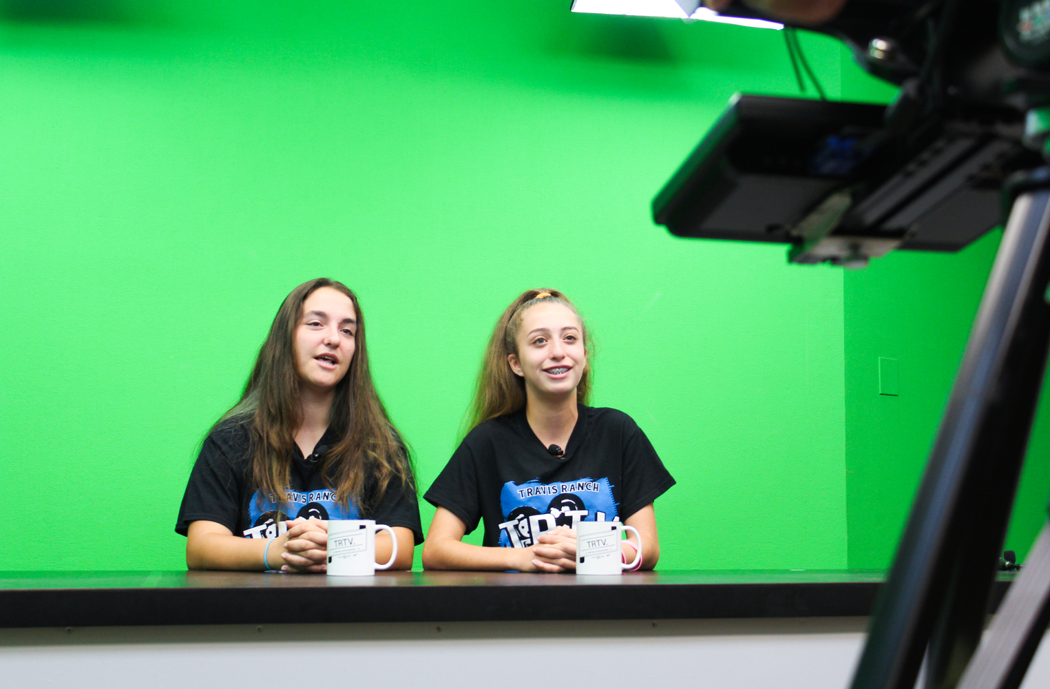 Students doing a newscast.
