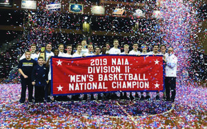 Thornapple Kellogg graduate Tom Hamilton and the Spring Arbor University Men's Basketball team celebrate winning the NAIA National Championship after an 82-76 victory over Oregon Tech in the finals of the NAIA Division II Tournament March 12 in Sioux Falls, SD. (Photo courtesy Spring Arbor University)