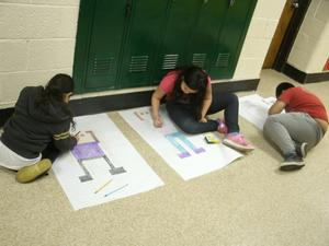 Third graders used robots and graph paper to study area.