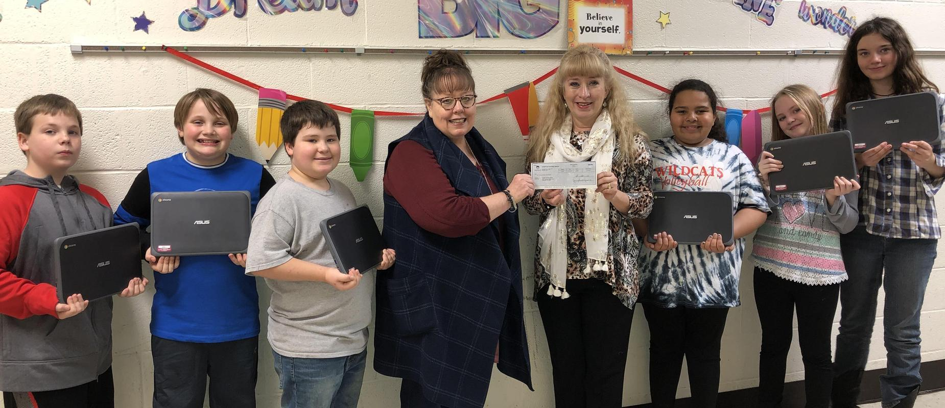 students with teachers with check for reward for chrome books