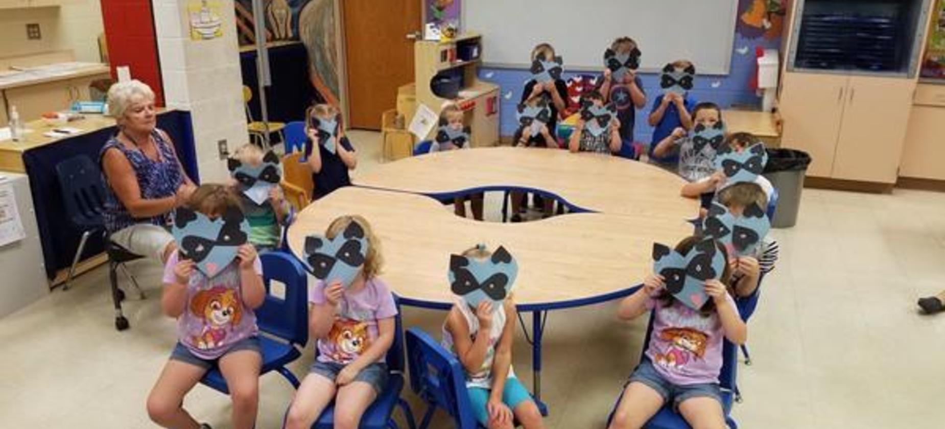Preschool students displaying their artwork