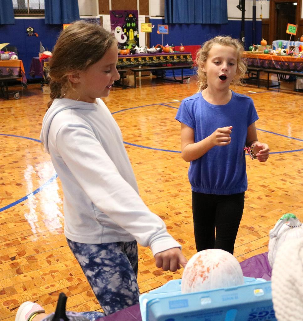Photo of students enjoying decorated pumpkins at  Wilson School Pumpkin Patch