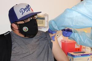 EMCSD staff member receiving vaccine