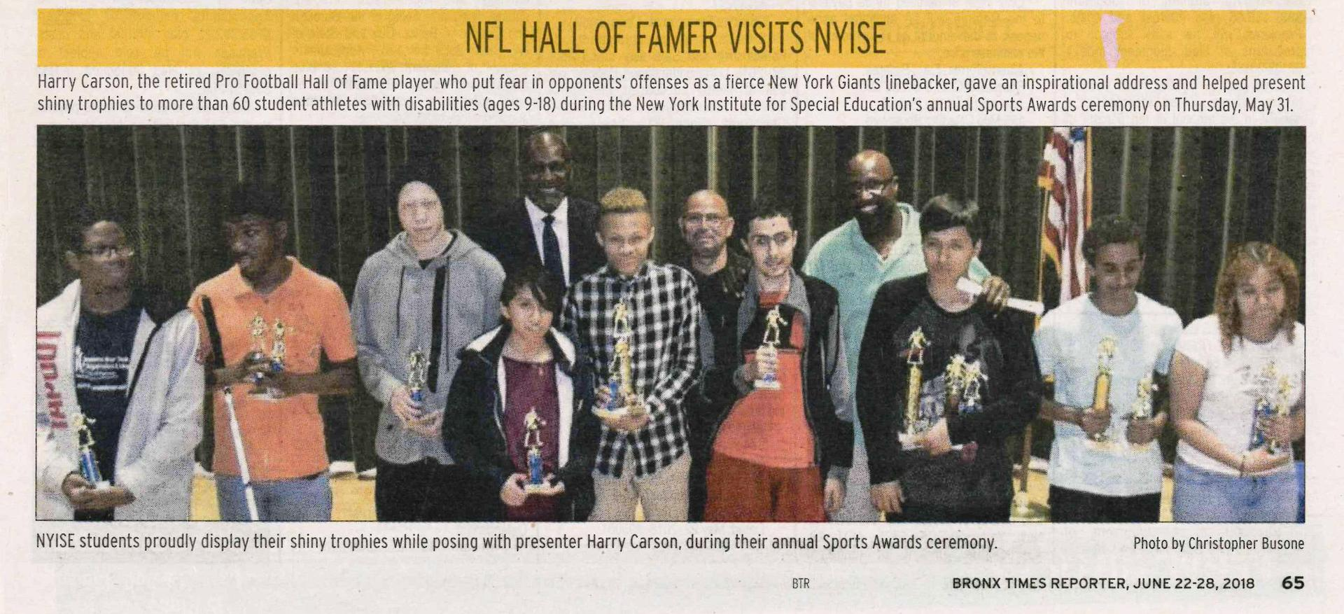 Students with NFL Hall of Famer Harry Carson with athletes.