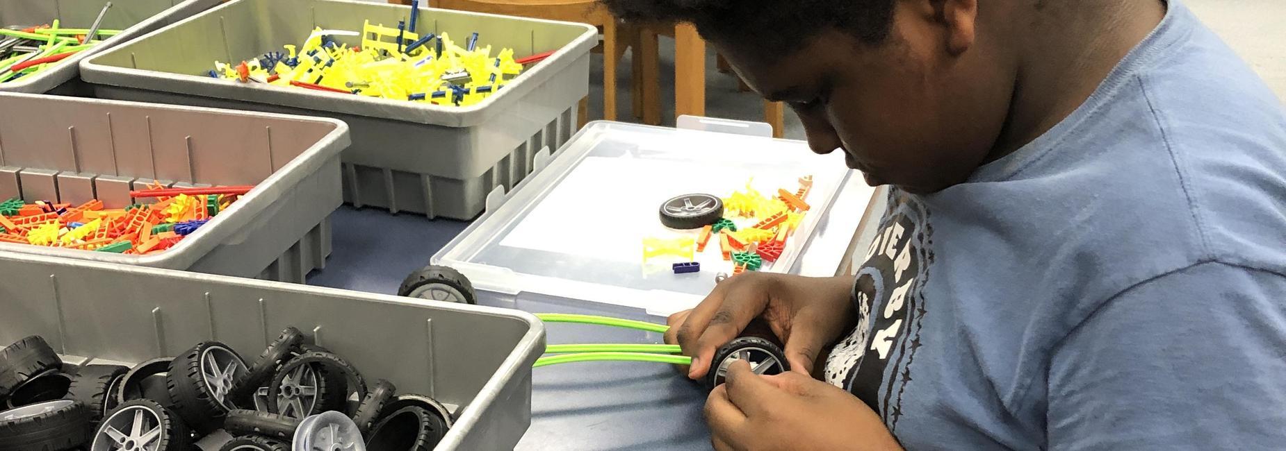 student working with K'Nex in STEM lab