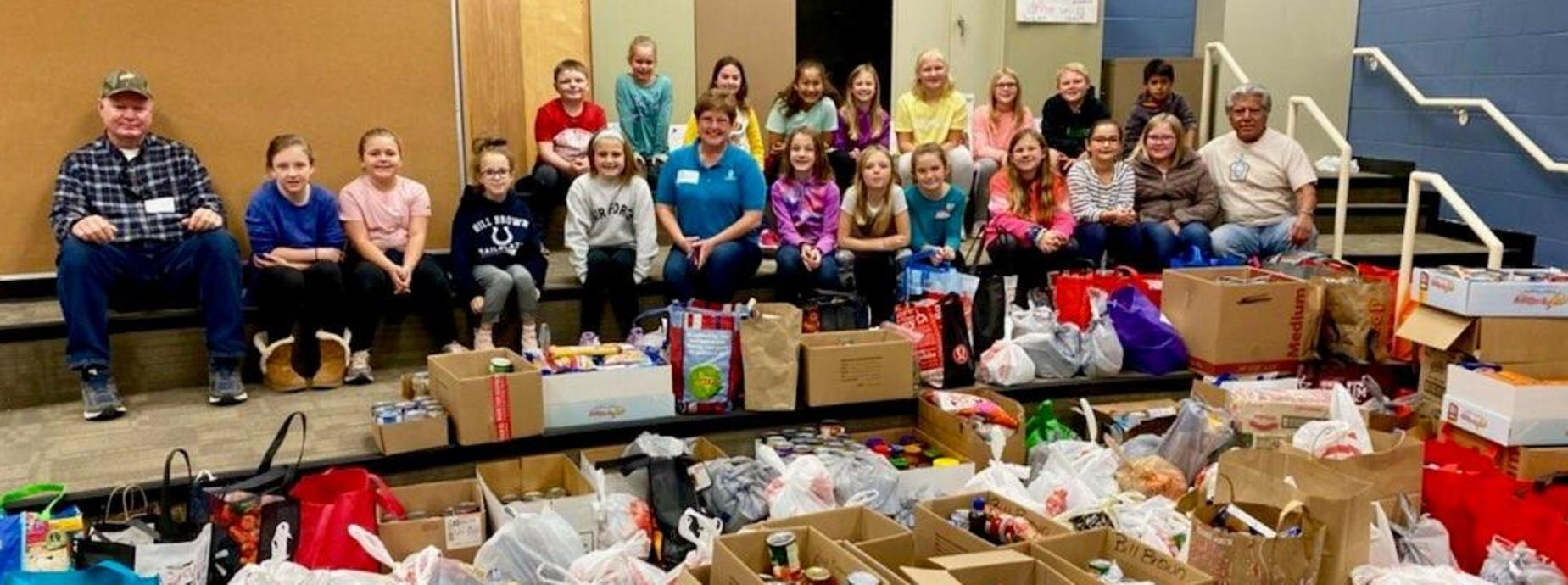 Student Council Representatives with volunteers from Provisions Outreach with all donated items.