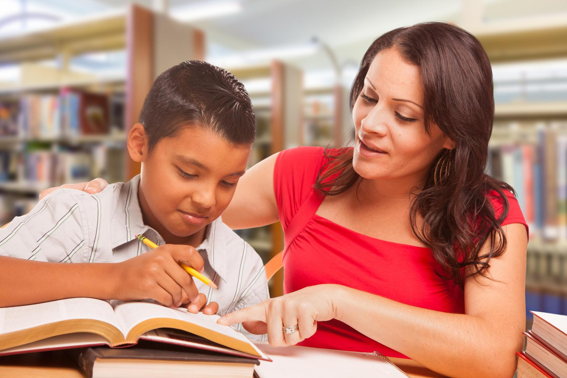 Teacher reading with student