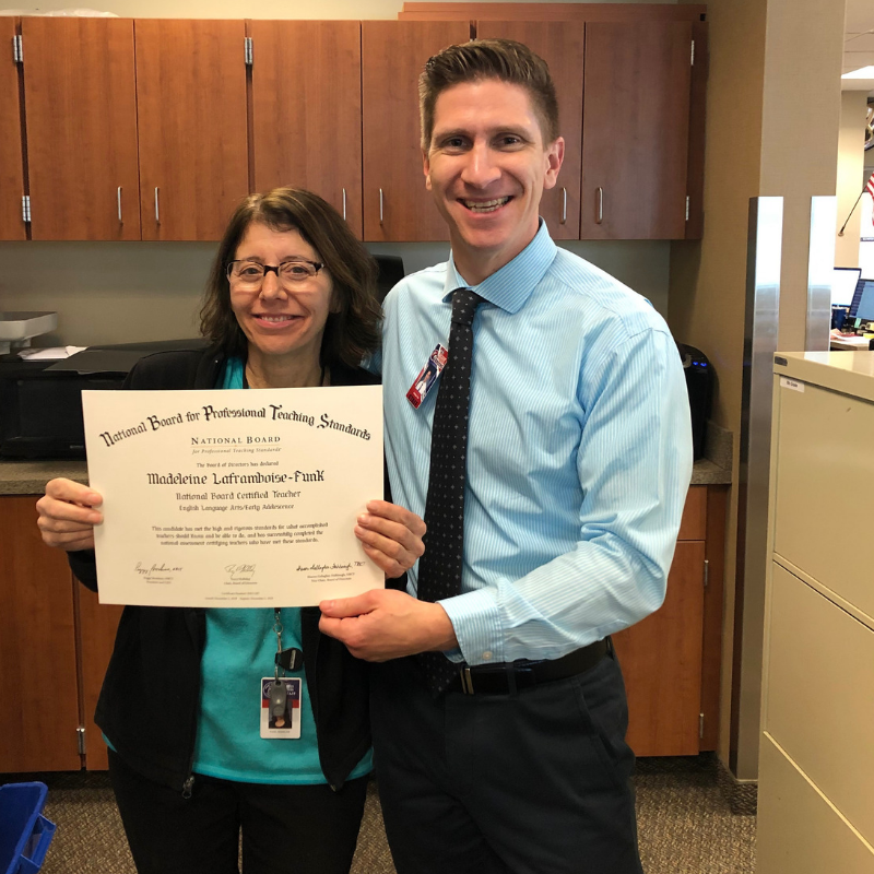 Mrs. Funk holding her National Board Certificate with Principal, Mr. Toth.