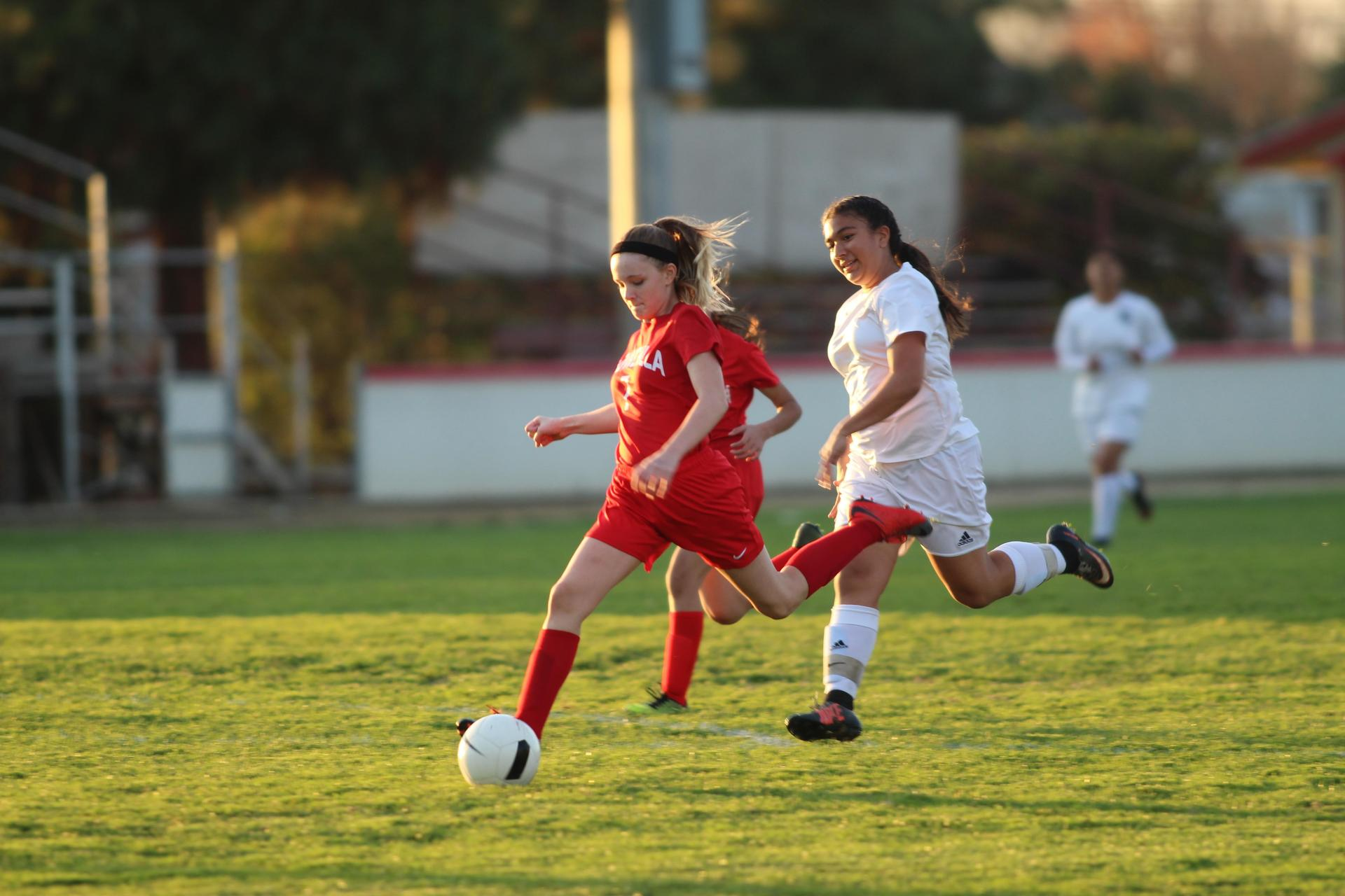 Girl's playing soccer against Merced.
