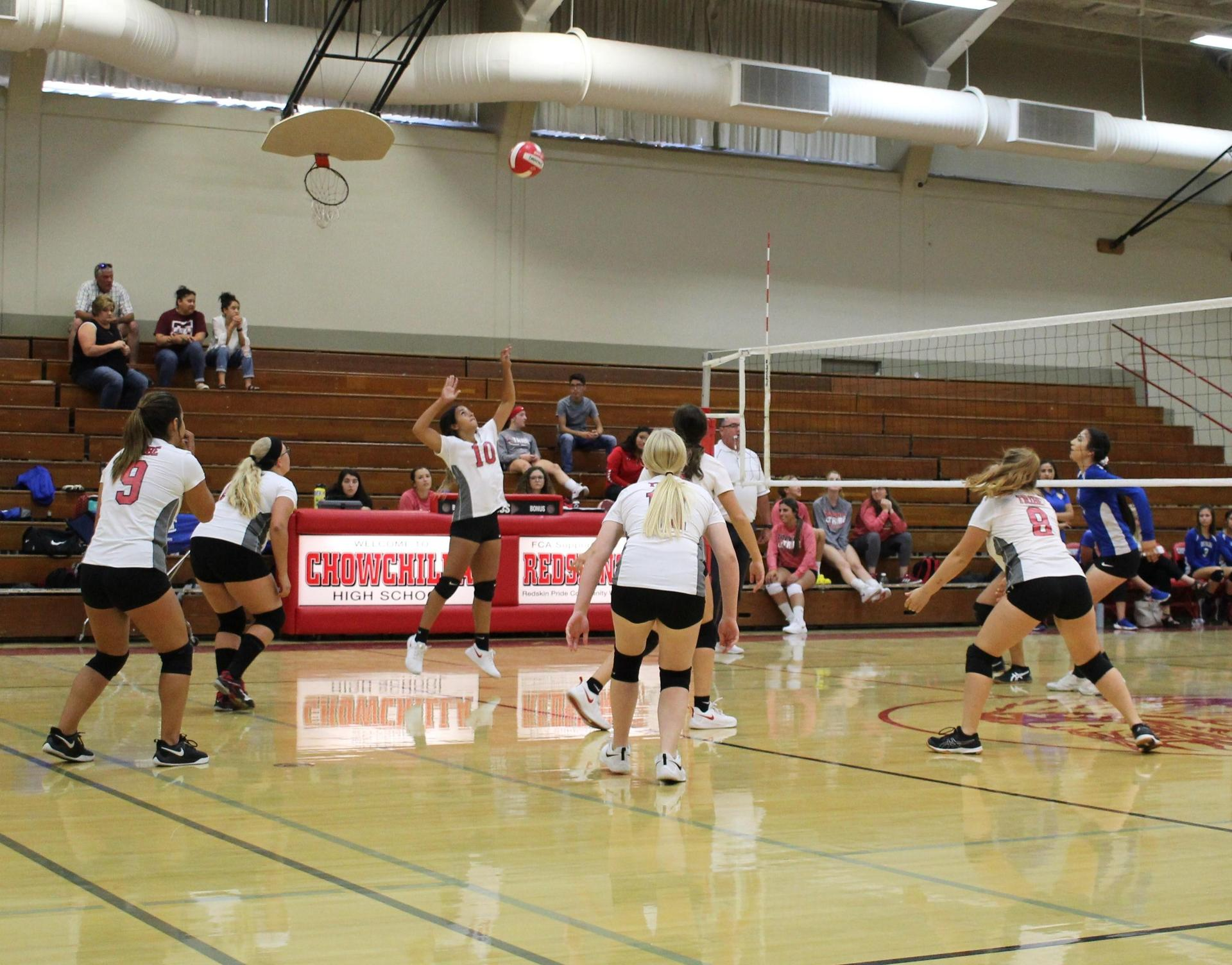 jv girls playing volleyball against dos palos