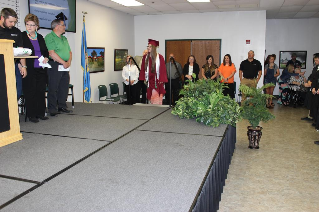 Student walks to stage