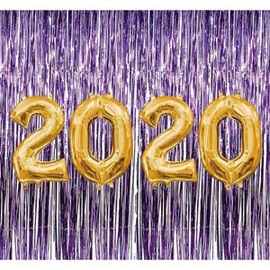 Photo of  balloons spelling out 2020 on a purple shimmering background