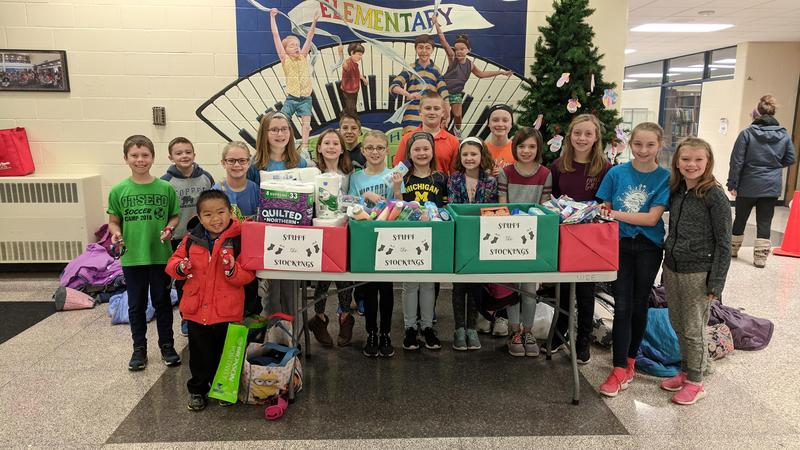 The student council members pose with the donations.
