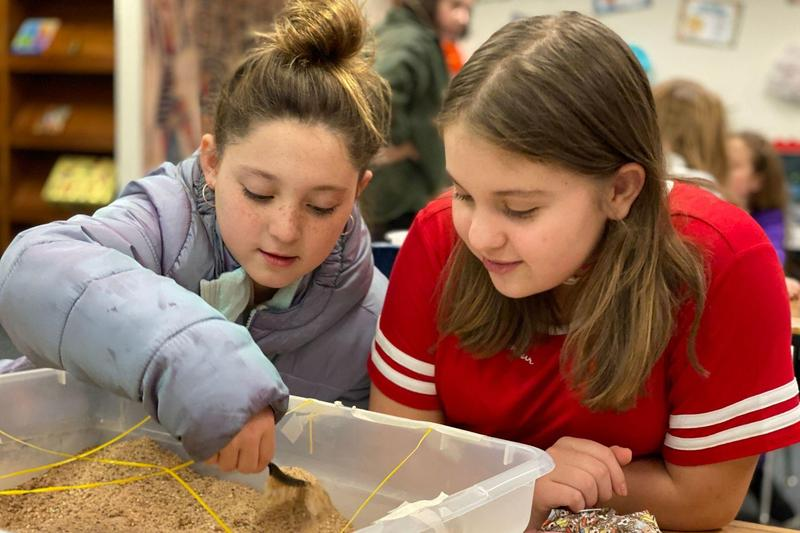 students dig in sanpits