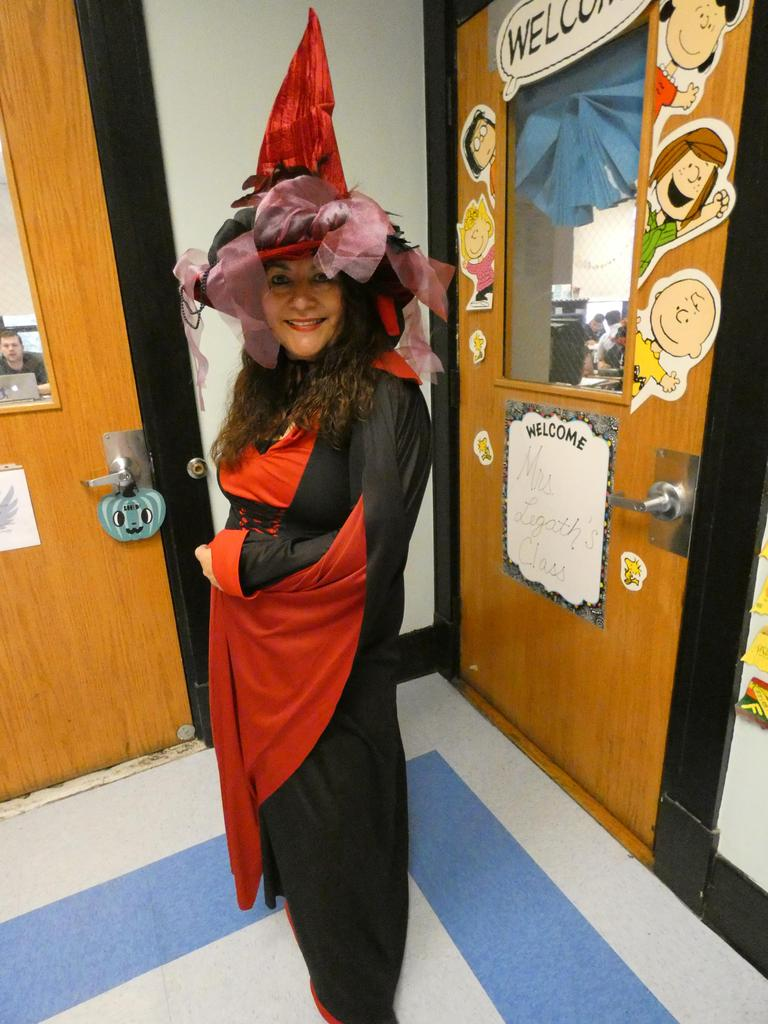 school  nurse dressed as a red witch