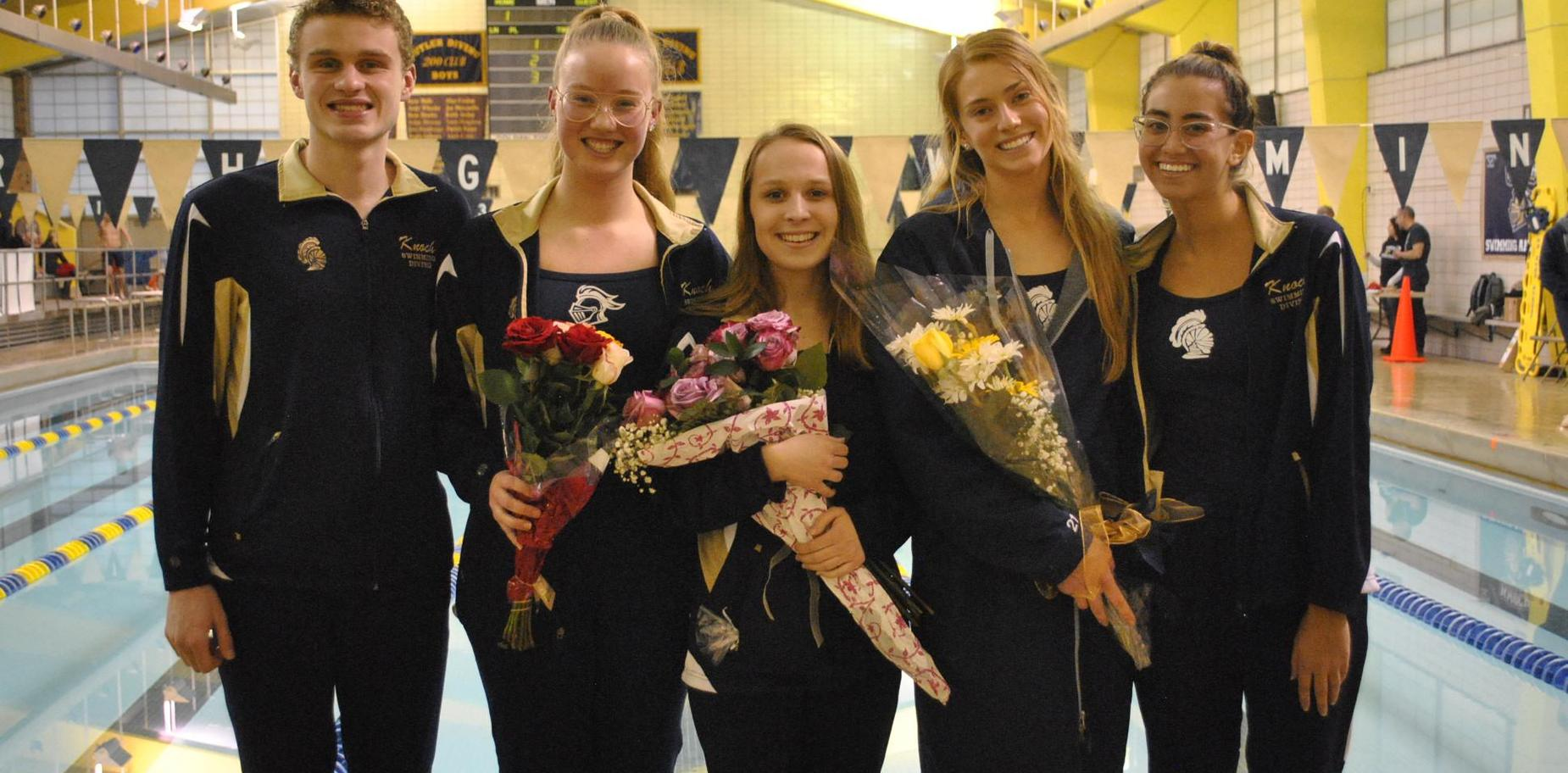Knoch Swim and Dive Seniors in front of pool