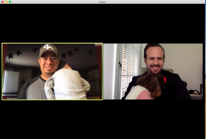 Two Edlio employees holding their children while on a virtual call.