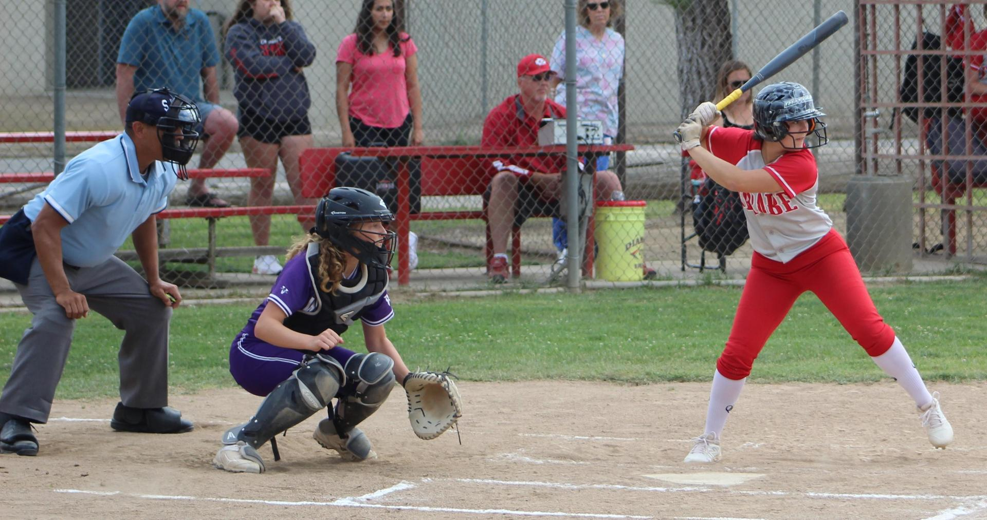Softball players in action against Washington Union