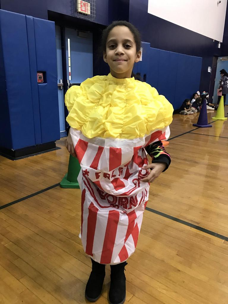 boy dressed as a tub of popcorn