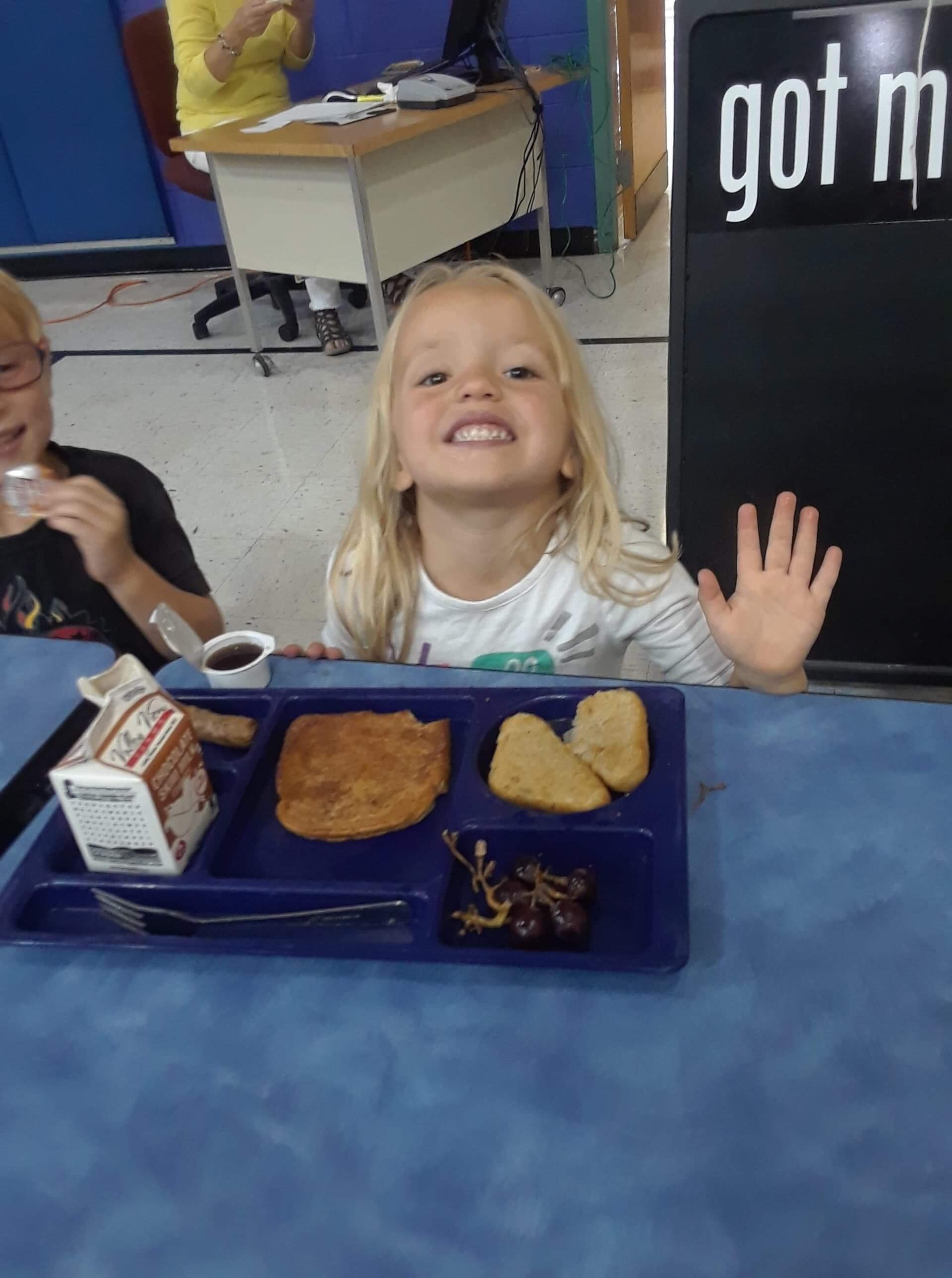 Child enjoying grilled cheese