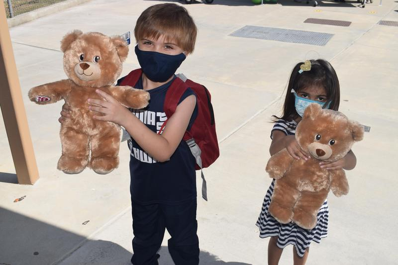 Shirpser School students show off teddy bears during a special donation event held at the school on Sept. 21. L.A. nonprofit Baby2Baby provided El Monte City families with backpacks, school supplies, new clothes, and other necessities to help District families meet their back-to-school needs.