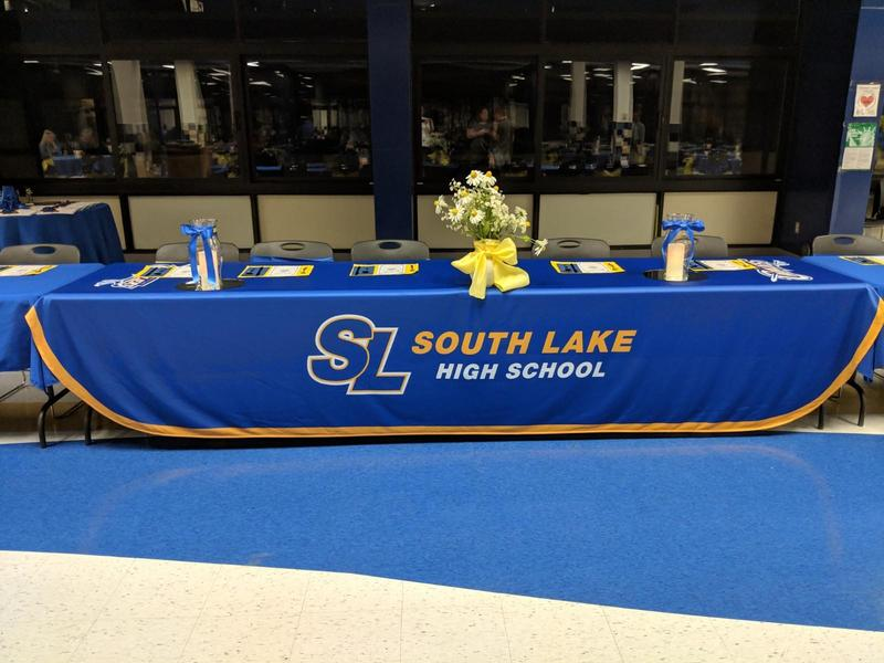 head table with the South Lake banner displayed
