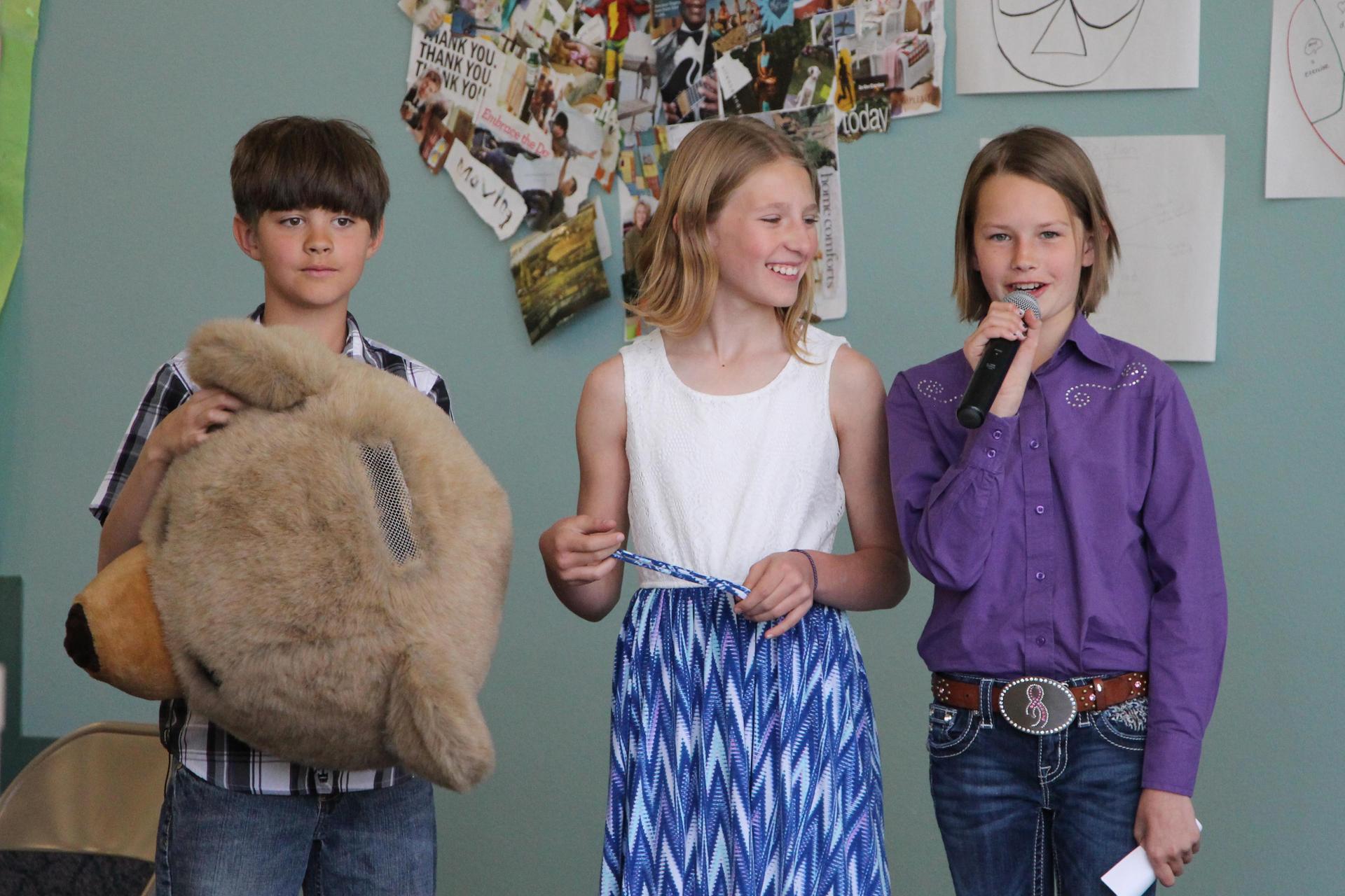 three students give presentation