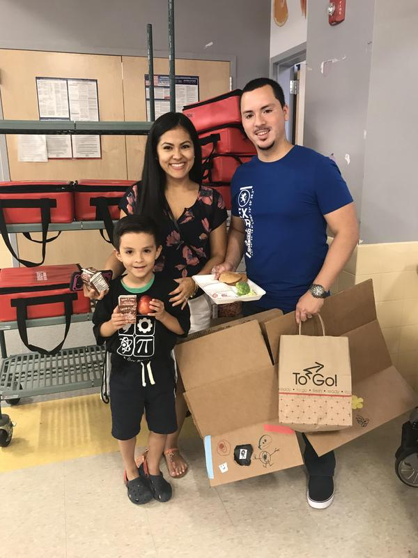Happy Family enjoying summer food program