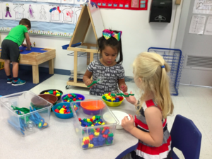 Students work on developing their fine motor skills