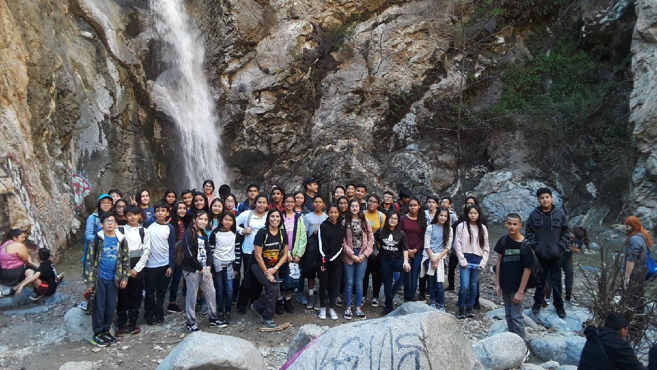 Students at the waterfall