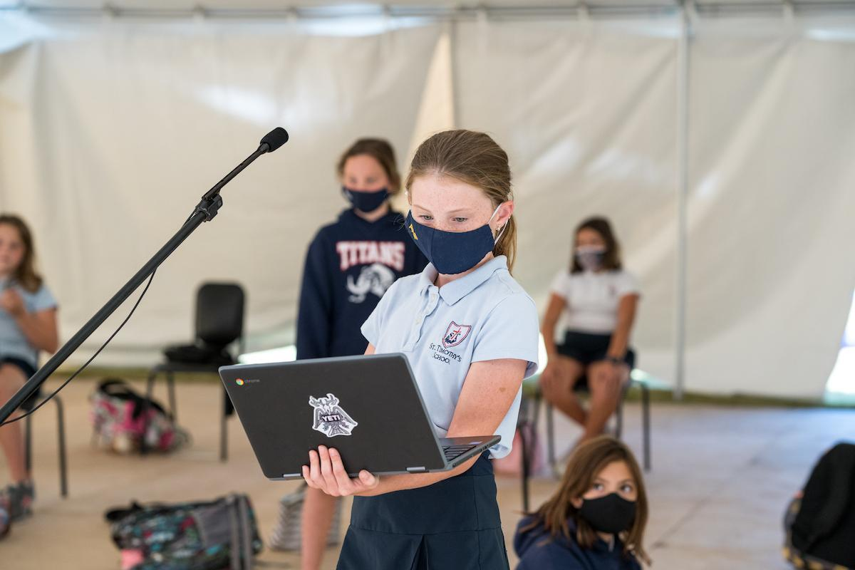 St. Timothy's School fifth grader reading her script in drama class