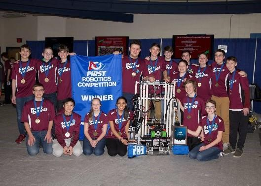 RoboDawgs team in maroon shirts stands with award