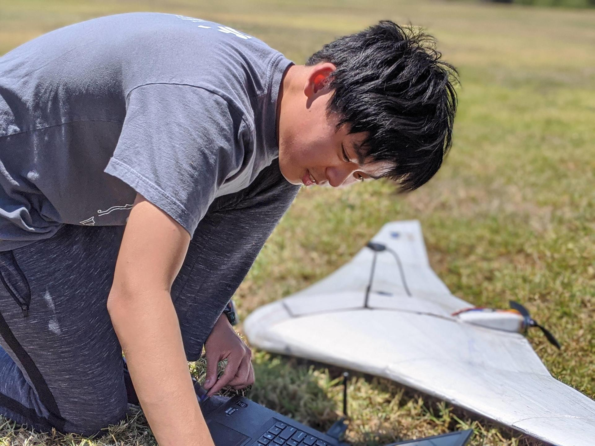 Ethan Wong working on his plane