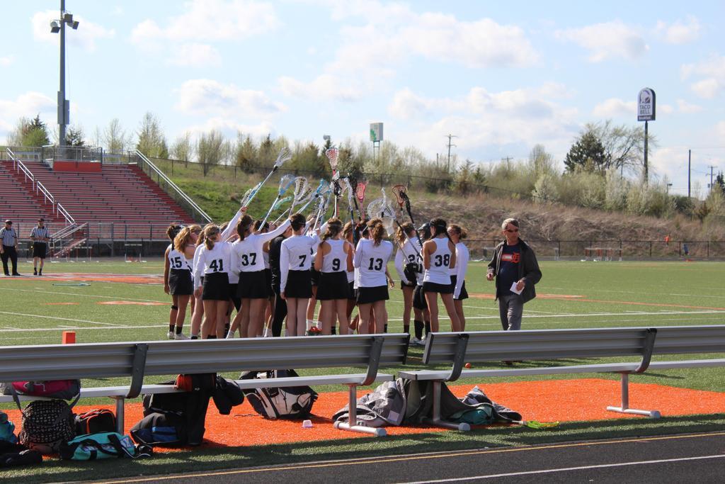 Women's lacrosse team on field