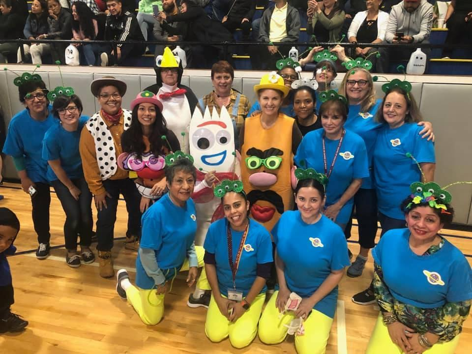 staff dressed as Mr. & Mrs. Potato Head with alliens