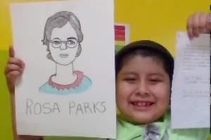 Student holding up Rosa Parks drawing