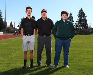 Golf team with coach - photo courtesy of Northwest Sports Photography