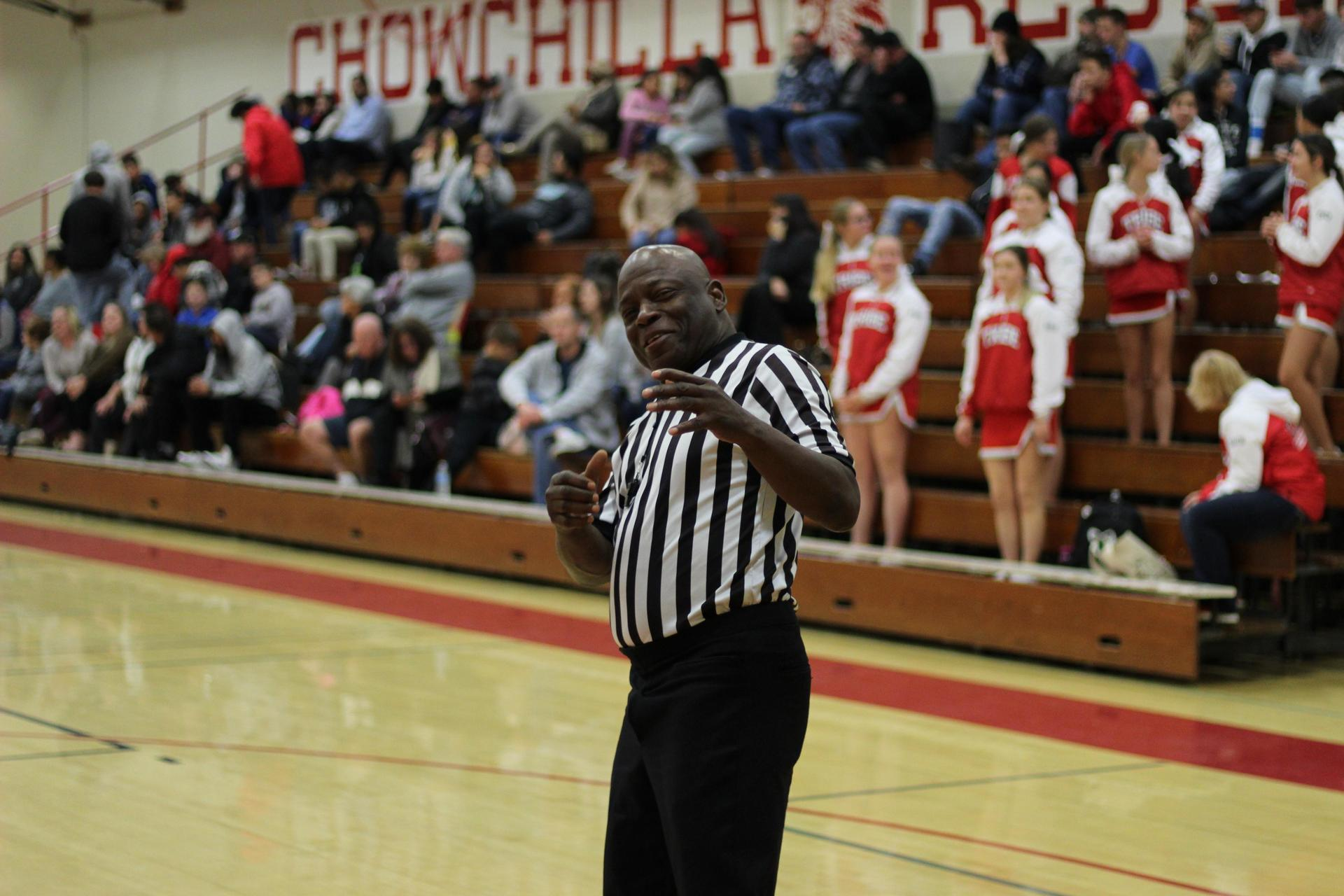 An official posing at the Mendota basketball game.