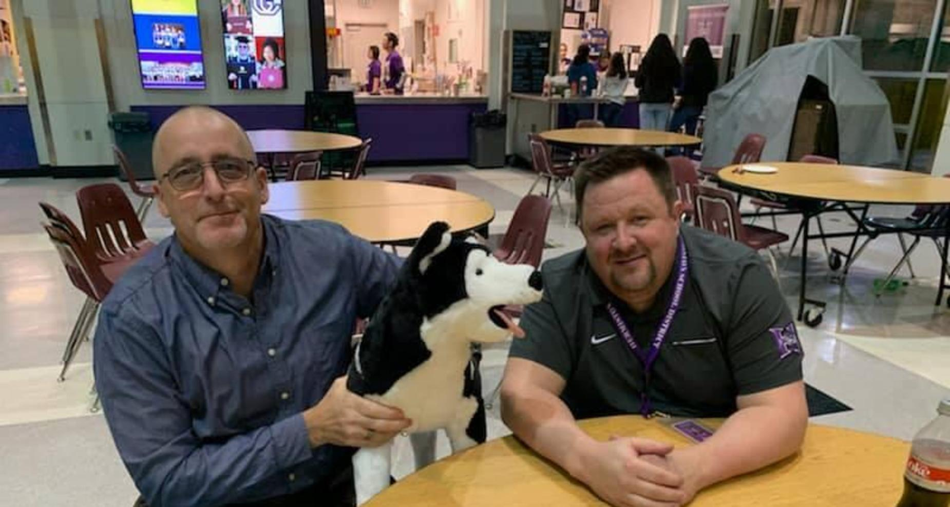 Mr. Spoo and Mr. Usher with Husky dog.