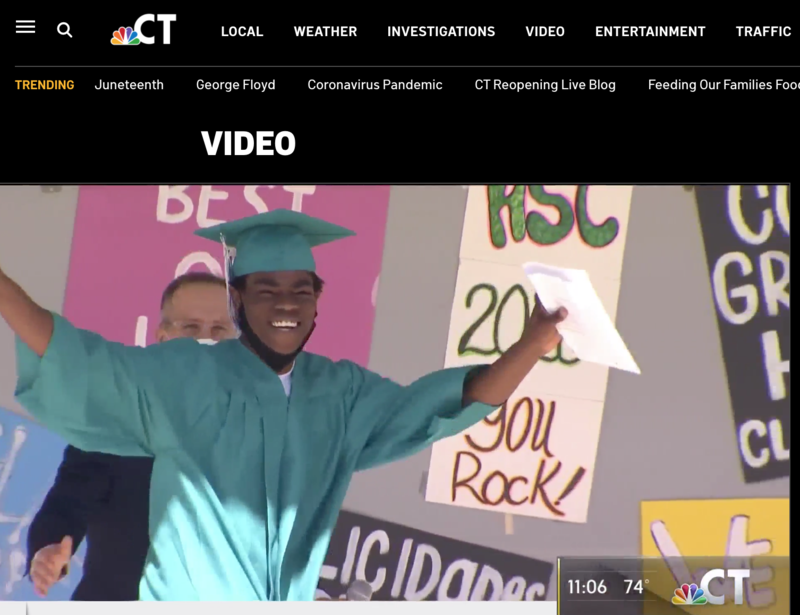 Student celebrates receiving his diploma